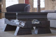The Sleepers Coffee Table features salvaged rail from either the Tennessee Coal & Iron Company or the L&N Railroad. Crafted…