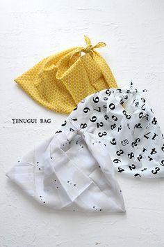 100円ショップでもたくさんの柄の手ぬぐいが手に入ります。 こちらはキャンドゥの手ぬぐいで作ったあずま袋たちです。
