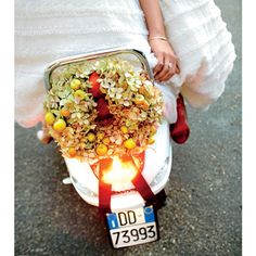 Brides Magazine: Lindsay & Michael in Tuscany - A wreath of hydrangeas and crab apples decorated the scooter