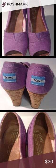 💕💕💕TOMS Wedges Size 8.5 purple Cute TOMS wedges in good used condition. Some signs of wear with visible toe marks which is reflected in price. TOMS Shoes Wedges