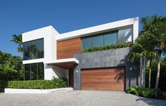 Designed for a nature and outdoors loving couple and their children, this house was conceived as a refuge from every day hectic lives.  Located on a 12,000 square foot waterfront lot in Golden Beach Florida, the scheme was designed as a narrative of the family's love for green, quiet and light...