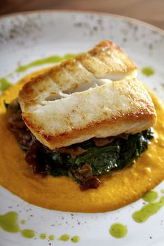 Oven roasted halibut with onion confit, sautéed spinach, sweet carrot puree at Cedar + Stone at JW Marriott Minneapolis Mall of America