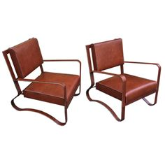 Jacques Adnet Pair Of Rare Lounge Chairs In Hand Stitched Leathe  FRANCE  1940s  hand stitched brown leather pair of lounge chairs by JACQUES ADNET