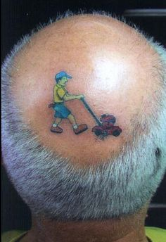 For a small fee, this little guy will be happy to cut grass on your head - Top 15 Weirdest Tattoos