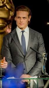 Image result for sam Heughan smart on suit b/w