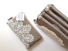 These vintage style clutches are made using a high quality, densely woven linen burlap fabric and each bag has a different vintage doily machine sewn securely to the front. The bags are fully lined with a ivory colored cotton fabric and they close with a beige colored nylon zipper.