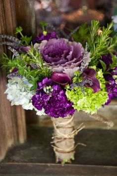 Purple and green bouquet | Photo by Sweetwater Portraits