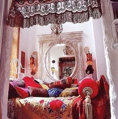Turn a corner of your house to an eclectic meditation room with the use of vintage scarves, pillows, and fabric