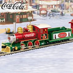 """""""COCA-COLA Holiday Express"""" Train Collection Coca-Cola® Holiday Express Train Collection Vintage-look holiday train set featuring COCA-COLA® trademarks and classic artwork. Lights up! FREE 16-piece track and power pack - a $70 value! Train cars run on HO train track; complete oval track measures 38"""" x 56""""  Price: $69.95"""