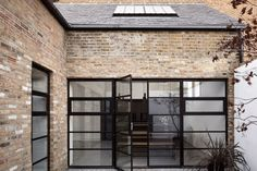 The founder of east-London architecture studio Paper House Project has transformed a former warehouse in Hackney into a two-bedroom house. Large Windows, Windows And Doors, Warehouse Home, Warehouse Renovation, Two Bedroom House, Derelict Buildings, London Architecture, London House, Types Of Doors