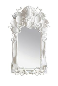 Jabberwocky mirror framed in plaster casts of found objects.