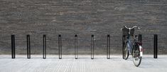 A solid, yet slim bollard and bicycle stand for bikes combined with integrated solar power.Free light – no cables – no installation issues. Bollard Lighting, Solar Powered Lights, Pedestrian, Urban Landscape, Urban Design, Light Up, Cable, Southern, Bicycle