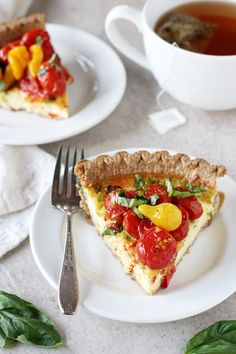 Recipe for tomato and goat cheese quiche. A simple, make ahead dish filled with green onions and goat cheese! Topped with plenty of roasted tomatoes!