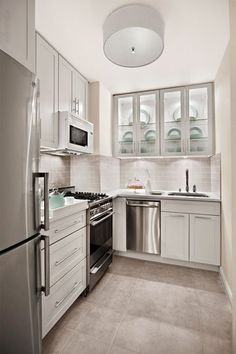A tiny, windowless kitchen with no natural light and only 54 square feet to work with. Is it possible to create an elegant, sophisticated kitchen for an avid cook who throws dinner parties nearly every weekend? Why yes! And it's absolutely beautiful. Take a look at this lovely before and after in a New York City studio apartment.
