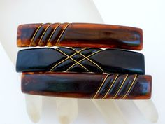 "Vintage Set of 3 Lucite Barrettes Brown & Black Hair Jewelry with Gold Trim Lot   This is a nice lot of 3 vintage lucite hair barrettes accented with gold trim.  These unique barrettes are 2.63"" x .5"" and in excellent condition, with no damage.Clothing, Shoes & Accessories, Women's Accessories, Hair Accessories"