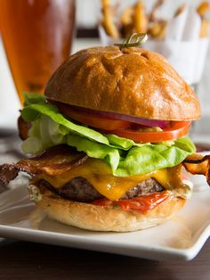 Paramour #Burger made with a custom Pat LaFrieda dry aged blend, cheddar, L.T.O., herb aioli & Lancaster bacon