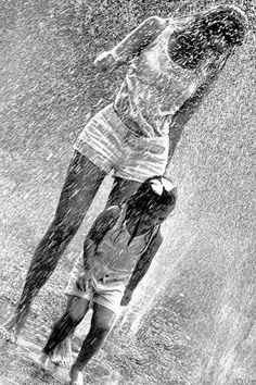 """Life isn't about waiting for the storm to pass…it's learning to dance in the rain."" You should always play in the rain with your kids.those moments are never forgotten and the sheer joy on their faces is priceless! Walking In The Rain, Singing In The Rain, Rainy Night, Rainy Days, Rainy Weather, Cool Umbrellas, I Love Rain, Rain Go Away, Rain Photography"