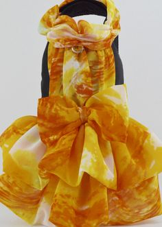 Designed for a Black Dog for Le Chien 2016 and worn by Annie Banana, a black Chihuahua, this dress is a sheer print of yellow and orange gathered around the neck, down the back and in a two tier very