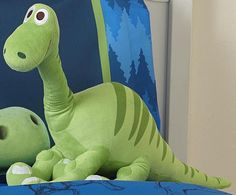 "AmazonSmile: Disney Good Dinosaur Arlo 26"" x 14"" Plush Pillow Buddy: Home & Kitchen"