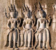 Three dancing apsara on the wall in Angkor Wat, Siem Reap