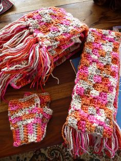 Ravelry:  Colorful Scarf and Wristies . Pattern Rowan's Wristies by Shirley MacDonald Corner Start scarf for mom and child. Both patterns on Ravelry, free.