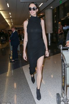 Leggy lady: Nicole Trunfio looked her usual stylish self as she strutted her stuff through Los Angeles International Airport with her fiancé Gary Clark and their adorable son, Zion, on Thursday afternoon