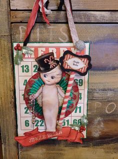 My cute little kewpie is back with more Christmas cheer! This Christmas bingo card has tons-o-stuff added to her! This is a beefy card! Christmas Bingo Cards, German Toys, Kewpie, Card Crafts, Bisque Doll, Jingle Bells, Altered Art, Cheer, Printables
