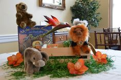 All the Awake Animals centerpiece. Wooden crate, fake grass and flowers.