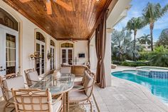 Hosting parties is a breeze (a balmy one, at that) at this Boca Raton home.
