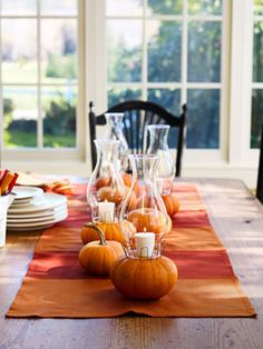 Set the Mood: Put mini pumpkins to work as votive holders for a flickering fall table. Click through for more enchanting Halloween decorations! Halloween Veranda, Fall Halloween, Halloween Pumpkins, Halloween Table, Halloween Party, Halloween Candles, Happy Halloween, No Carve Pumpkin Decorating, Pumpkin Carving