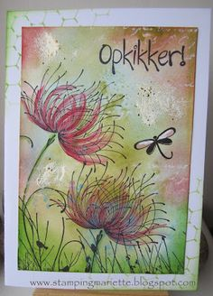 """By Mariëtte van Leeuwen. Background is made up of different layers and colors of distress inks and paints. And here and there embossing enamel was used. Stamp is """"Dreamy"""" from Penny Black."""