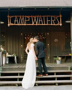 love this handmade 'Camp Waters' wedding sign the bride + groom made!