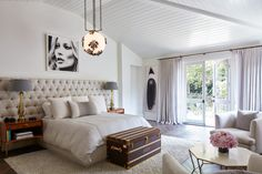 Cozy and quaint contemporary bedroom boasts style and grandeur from an extra long gray tufted headboard to a Louis Vuitton trunk at the foot of the bed. Living Room Grey, Living Room Sets, Bedroom Sets, Living Room Furniture, Furniture Sets, Bedroom Decor, Master Bedrooms, Bedroom Inspo, Bedroom Inspiration