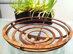 This contemporary fruit bowl is made of 6 layers of laser cut veneer timber, interlocked with 2 frames that cross over. The bowl comes flat pack and is easily assembled.  The bowl featured here is made of myrtle timber but is available from your choice of quality veneer timbers.