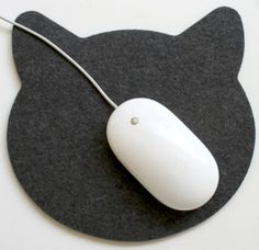 This adorable cat mouse pad is the purrfect way to add a little cat love to your office! http://moderncat.com/blogs/modern-cat/cute-cat-face-mouse-pad