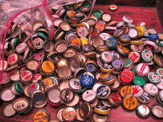 How to make a beer bottle cap table.  These are super cool and colorful!