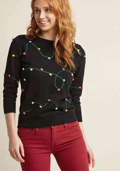 "<p>Light up the room with the lighthearted design of this black sweater! An ultra-quirky offering from our ModCloth namesake label, this crew neck pullover touts winding green ""wire"" embroidery with colorful pom-pom ""lights,"" offering festive pep for the agest.</p>"