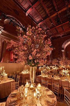 Photo: Cava Weddings; Splendid ballroom cherry blossom wedding centerpiece