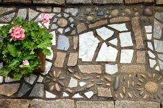 Detail of the mosaic walkway, composed of cut and uncut granite mixed with pieces of discarded marble and granite countertops.