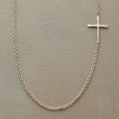 """Superfine links uphold a hand hammered cross set to one side of Rebecca Lankford's sterling silver necklace. Handcrafted in USA with a spring ring clasp. Cross is approx. 1/2""""L"""