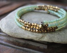 Items similar to Kalimantan Stacking Memory Wire Bangle Bracelet with Matte Aqua Glass and Faceted Brass Beads - Exotic and Chic on Etsy Memory Wire Jewelry, Memory Wire Bracelets, Diy Jewelry, Bangle Bracelets, Beaded Jewelry, Jewelry Design, Jewelry Making, Beaded Necklaces, Jewellery