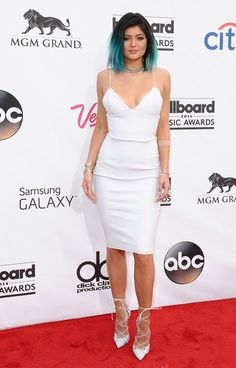 Kylie Jenner wears a white Alex Perry slip dress from the Spring 2014 collection paired with Christian Louboutin lace-up heels to the 2014 Billboard Music Awards.