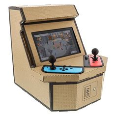 Nyko has unveiled its latest retro arcade kit. Using the cardboard kit, you can turn your Nintendo Switch into an arcade cabinet that supports two players. Arcade Stick, Mini Arcade, Retro Arcade Games, Donkey Kong, Game Boy, Super Nintendo, Mega Drive 2, Arcade Buttons, Videogames