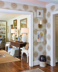 Interior designer Maggie Griffin wallpapered her tiny entry, added a collection of art, and painted the ceiling blush pink