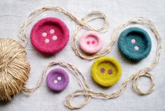Felt buttons - may be brooches or used in crafting. By Issa Felt