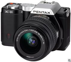 Pentax K-01   compatible with all k-mount lenses, but bigger because of it