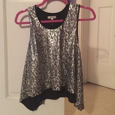 New w/o tags sequin cheetah print tank top. Size S Brand new w/o tags! Adorable silver and black metallic top with sequin detail on front and back! Size S. A great boutique find!! Tops Tank Tops