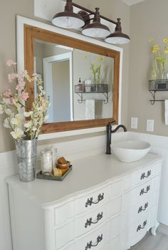 paNew and Improved Farmhouse Bathroom Vanities. How to cover bathroom vanities with a clear polycrylic topcoat.