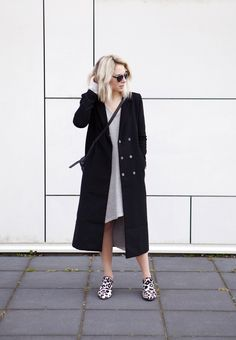 Street Style, May 2015: Lian Galliard is wearing a black H&M mac coat with a pale grey One Teaspoon dress and animal print Senso flat shoes