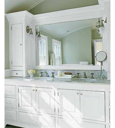 Custom cabinetry, crown molding and a curved vaulted ceiling create a seamless look in this storage-packed master bath. | Photo: Laura Moss | thisoldhouse.com
